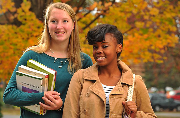 two female honors program students